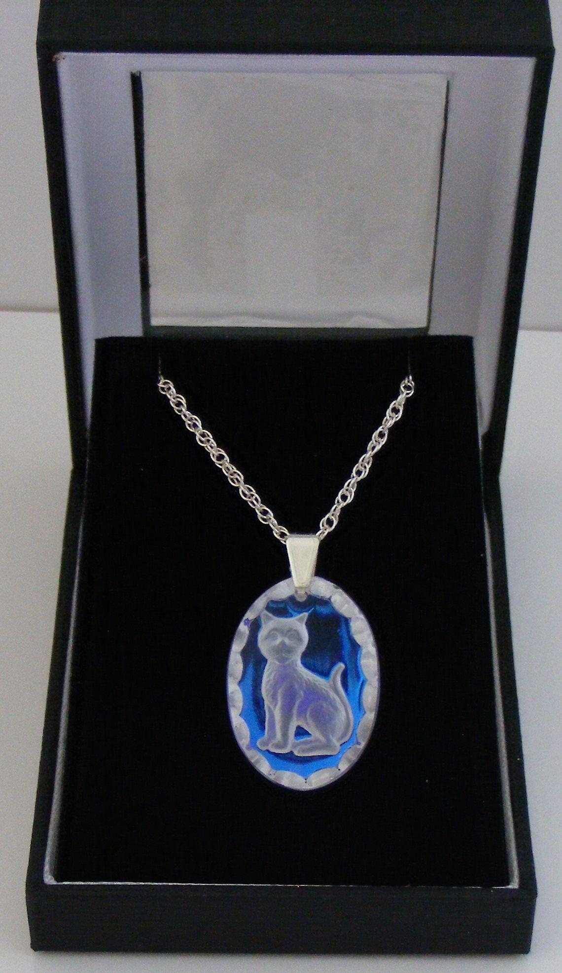 Ice Blue Oval Cat Crystal Pendant