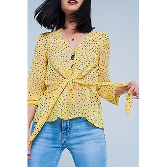 Yellow blouse in polka dot with tie waist detail