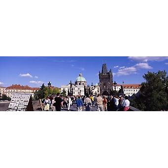 Tourists walking in front of a building Charles Bridge Prague Czech Republic Poster Print