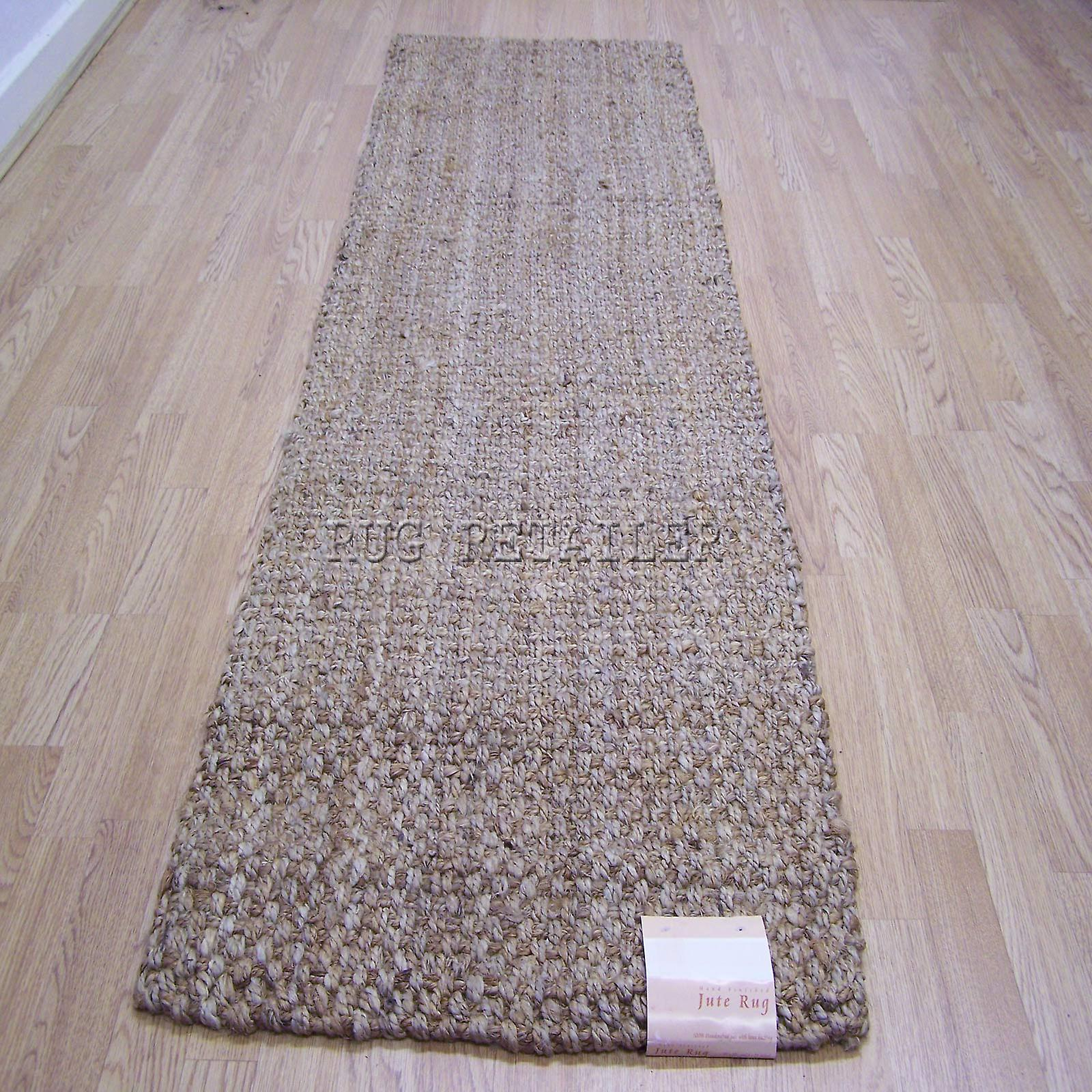 The Anji Mountain Mira Jute Rug features a The Anji Mountain Mira Jute Rug features a large boucle weave and brings a magnificent chunky texture to nearly any space. This rug is expertly handloom-woven by skilled weavers who employ traditional techniques to create this simply beautiful style.