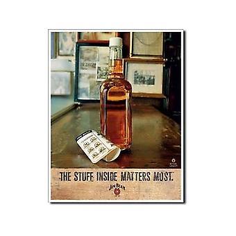 Cosas de Whiskey Jim Beam dentro de muestra del Metal
