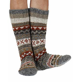 Finisterre warm handmade wool knee-high socks in earth | By Pachamama