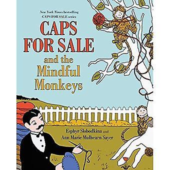 Kasketter til salg, og de opmærksomme aber