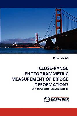 CLOSERANGE PHOTOGRAMMETRIC MEASUREMENT OF BRIDGE DEFORMATIONS by Leitch & Kenneth