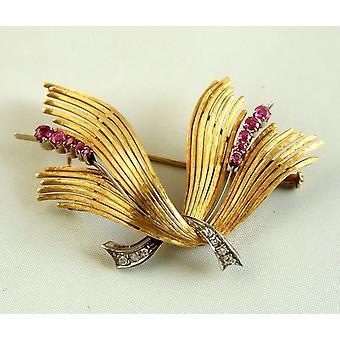 Broche de oro con diamantes y rubíes