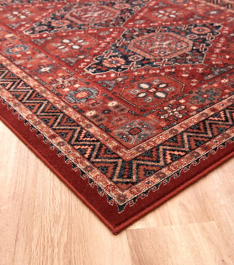 Kashqai 4308_300 Red and russet ground with diamond formation in the centre and a zig zag border Rectangle Rugs Traditional Rugs