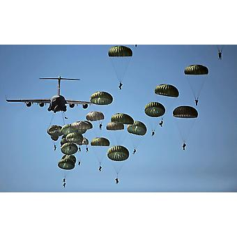 US Army paratroopers jumping out of a C-17 Globemaster III aircraft Poster Print by Stocktrek Images