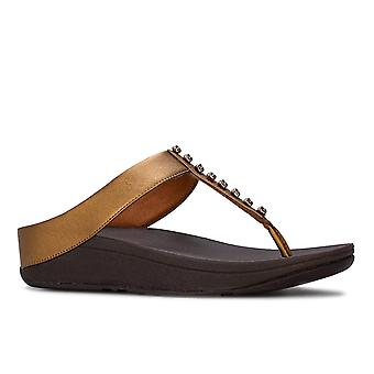 Womens FitFlop Fino Treasure Toe Thong Sandals in bronze.