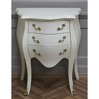 Creme colored vintage chest of drawers with brass