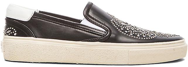 Saint Laurent Women's studded slip-on shoes in black calf leather white sole