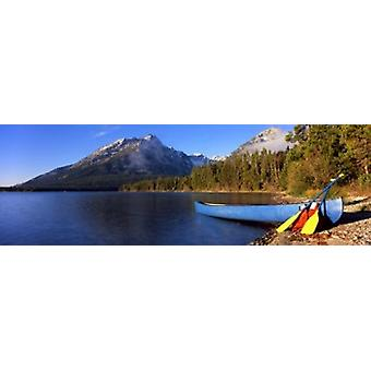 Canoe in lake in front of mountains Leigh Lake Rockchuck Peak Teton Range Grand Teton National Park Wyoming USA Poster Print
