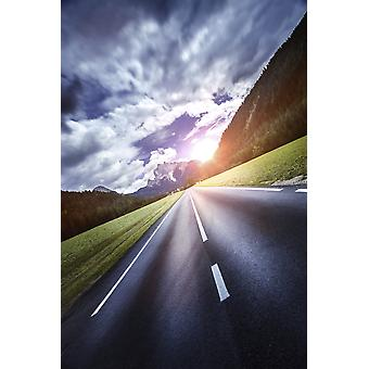 An asphalt road leading to the Dolomite Alps at sunset Northern Italy Poster Print