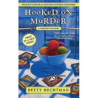 Accroché sur le meurtre de Betty Hechtman - livre 9780425221259