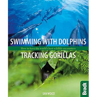Swimming with Dolphins Tracking Gorillas by Ian Wood
