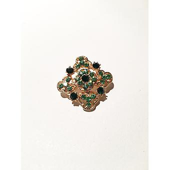 Gold and green brooch