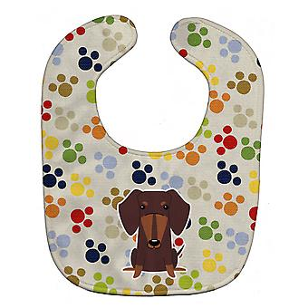 Carolines Treasures  BB5960BIB Pawprints Dachshund Chocolate Baby Bib