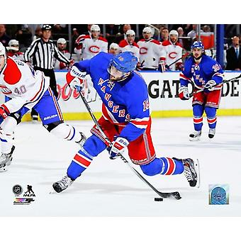 Derick Brassard of the New York Rangers takes a shot on goal in the third period of Game Six of the Eastern Conference Final against the Montreal Canadiens during the 2014 NHL Stanley Cup Playoffs at