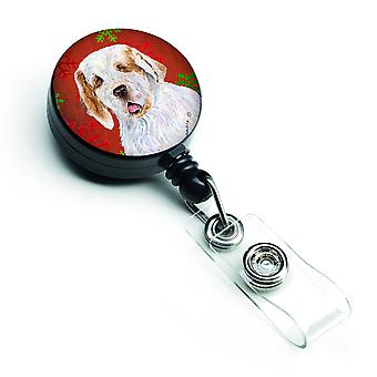 Clumber Spaniel Red and Green Snowflakes Holiday Christmas Retractable Badge Ree