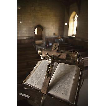 UK Scotland Scottish Borders Yetholm Open bible on stand with a crucifix PosterPrint