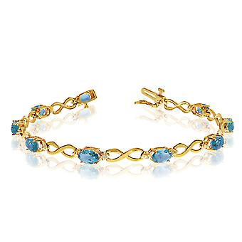 14K Yellow Gold Oval Blue Topaz and Diamond Bracelet