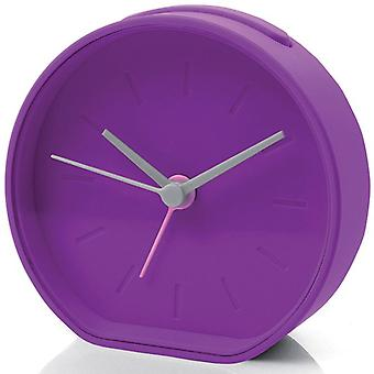 Purple Lexon Beside Analogue Alarm Clock