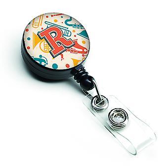 Lettera R retrò dell'alzavola arancia strumenti musicali iniziale retrattile Badge Reel