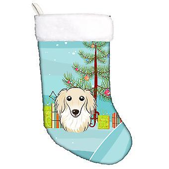 شجرة عيد الميلاد وعيد الميلاد تخزين ذي الشعر الطويل الكلب الألماني كريم