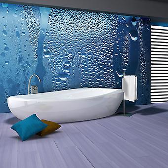 Behang - Water druppels op blauw glas